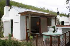 "The deck and outside fireplace at ""Adam se huis"" New Modern House, Outside Fireplace, Self Catering Cottages, Open Plan, South Africa, Deck, The Originals, Heart, Outdoor Decor"