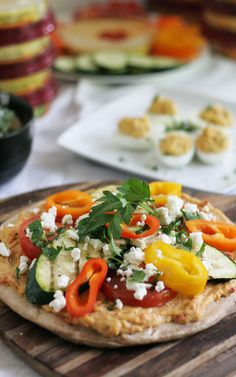 Grilled vegetable and hummus flat bread pizza. Great recipe for parties, warming weather, and it's healthy! ::not just baked::