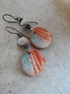 Gorgeous primitive polymer clay charms, expertly handcrafted by Asia at Winter Bird Studio, are perfectly paired together with rustic ceramic beads,