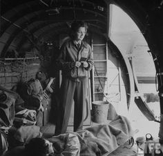 Flight Nurse Julia Corinne Riley, waiting for another ambulance with her last patient aboard a C-47 transport plane, which ferried the wounded soldiers from the North African battlefields to hospitals in the rear. April 1943 ~