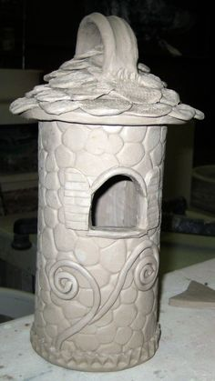 I like this cylindrical birdhouse and the plans that go with it!  http://applesloveorangespdx.blogspot.com/2011/02/bird-houses-double-doodles-and-150.html