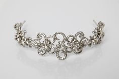 Estelle Tiara: This stunning collection of delicate flowers and Swarovski studded swirls sit elegantly on a handcrafted silver plated bridal tiara.