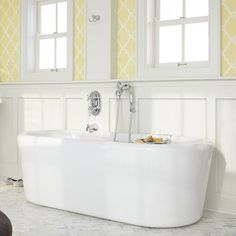 Unwind after a long day while soaking this luxurious bathtub. Crafted with acrylic, this tub boasts a contemporary design and a white color that will complement any exisiting bathroom decor. <br><br><ul>...