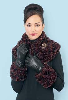 Follow this free knit pattern to create a stole and cuffs set usiing Bernat Boa eyelash yarn.