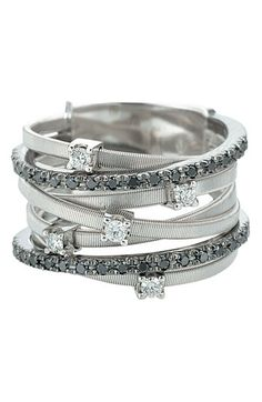 Stacked rings, white and black diamonds.