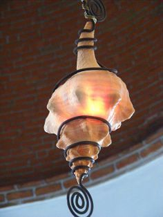 Conch shell lamp - how cool is that! And I just happen to have a couple of tho.Conch shell lamp - how cool is that! And I just happen to have a couple of those shells!A black and white theme bathroom with a light gre. Seashell Art, Seashell Crafts, Beach Crafts, Coastal Homes, Coastal Living, Coastal Decor, Coastal Cottage, Shell Lamp, Shell Pendant