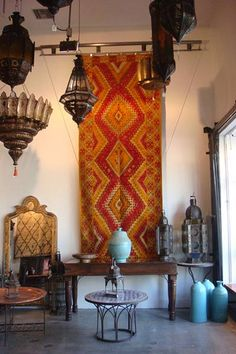 Moroccan rugs as wall hangings. I like to walk on mine but it does look pretty