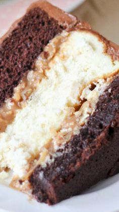 Chris' Outrageous Cheesecake Recipe ~ a copycat of the popular Cheesecake Factory dessert with layers of chocolate cake, brownie, cheesecake and coconut caramel pecan frosting!