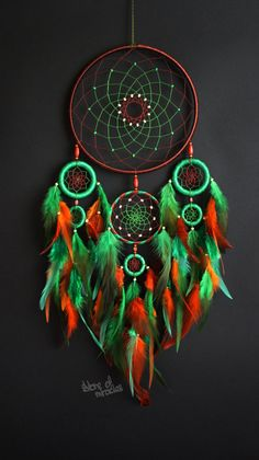 Dream catcher: Sizes: D19cm; 8cm; 5cm; 3.5cm (inches: 7,48; 3,15; 1,97; 1.38; ) The length 46cm (inches: 18,11) Materials used: Cotton yarn, feathers, feathers rooster, wooden beads. This Dreamcatcher will be made to order Dreamcatcher - is not just interior decoration. It is a powerful amulet, which is endowed with many properties: - Dreamcatcher protects and provides a sound sleep to the owner; - Dreamcatcher helps in practice lucid dreaming. It helps to understand the dreamer himself…