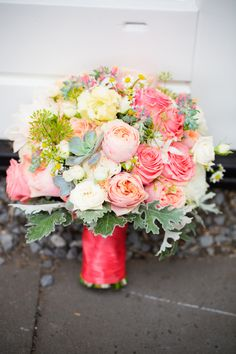 Pretty colors in this bouquet - corals, peaches and cream