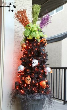 Halloween tree from a tomato cage.  I would not use the skull lights.