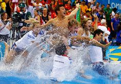 Britain's Tom Daley is thrown into the pool after winning bronze