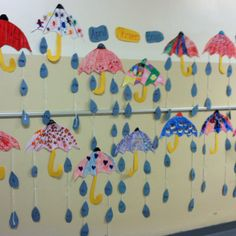 April Showers Bring....my students by using stencils made and designed their own umbrellas for Spring! I had some smiley face, spiderman, batman, rainbow umbrellas and many more-the students really liked designing their own and then they made raindrops and in each raindrop they wrote a red word. I tapes the raindrops onto yarn and attached them to the umbrellas so it looks like its raining! May flowers (with red words) to follow!!
