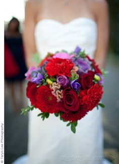 a red wedding flower bouquet with roses
