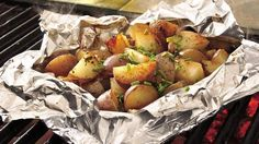 Season two types of potatoes with herbs and seasonings for a no-fuss side dish from the grill.