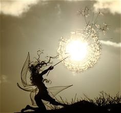 Fairy fighting to hold on to a Dandelion in the wind and spreading wishes everywhere.   By Fantasywire :)))