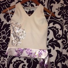 Halter top with sequence ! Gently used .. Knit and silk material with a sequence embroidery .. Tops
