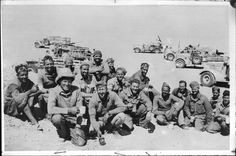 Group portrait of members of the Long Range Desert Group (LRDG) on patrol, 1941, Source: N.Z National Library