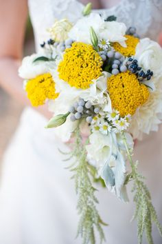 close up of dahlia, aster, dusty miller, lisianthus, yarrow, amaranthus, brunia and privet bouquet