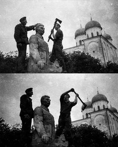 German Soldiers remove the head of a statue of Joseph Stalin