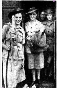 Signaller Joan Kessels (2nd from left) amongst first Queensland members of the AWAS who served in the Islands to arrive home.