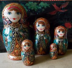 Author's nesting dolls matryoshka with painting in russian style khokhloma handmade. $98.00, via Etsy.