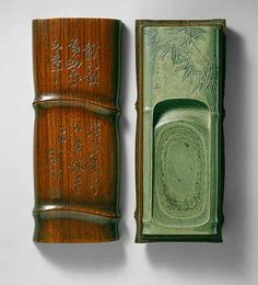 Green schist and wood, inkstone and box, Qing dynasty (1644-1911), early 18th century.  The green inkstone is carved in the shape of bamboo stem segments and is adorned in low relief with leafy branches rising from behind rocks.  The slanted surface of the sunken grinding area displays multiple layers of natural markings within the stone in purple and various shades of green. The wooden box is also carved in the shape of a length of bamboo.