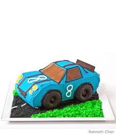 Car cake. Simple!! I made this for my son's first birthday and it was a hit! Of course, mine didn't look near as good as this one, but it was close!! This was the cake he tore into, I made cupcakes with black & white icing and arranged like a checkered flag
