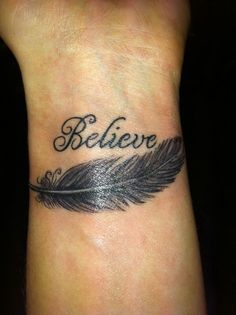 believe with feather on wrist