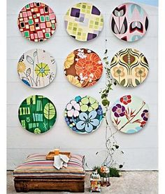 you could use embroidery hoops to frame fat quarters or remnants of fabulous fabric