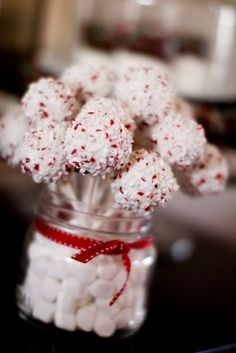 Strawberry & white cake pops. I love the marshmallow filler in the holder. Crushed peppermints and coconut coating
