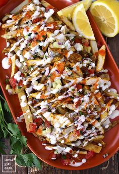 Chicken Shawarma Fries with Mediterranean Salsa and Garlic Sauce are a party on a platter! Full of delicious, fresh and bold flavors. #glutenfree | iowagirleats.com