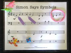 """Fun game to review music symbols and elements.  For example:  """"Simon Says… Place the blue hippo on a bass clef A""""  """"Simon Says… Place the pink rubber band around a set of notes that skip""""  """"Simon Says… Point a purple post-it flag at the symbol that tells you to play legato"""". #WestMusic #InspireMyClass"""