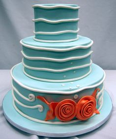 Fondant goldfish and ocean waves are a whimsical take on an ocean-inspired confection. Cake by Pink Cake Box