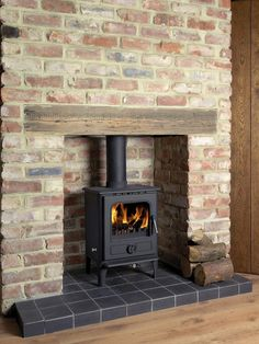 Looks like the wood stove version of my home hearth. Would this work in NH? Wood Burner Fireplace, Fireplace Hearth, Fireplace Surrounds, Fireplace Design, Wood Mantle, Fireplace Ideas, Brick Fireplace Decor, Brick Chimney Breast, Exposed Brick Fireplaces