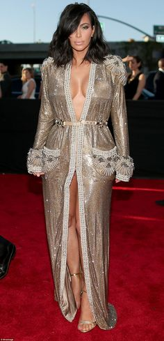 Sterling silver: Kim Kardashian oozed sparkle as she wore what looked to be a silver robe. The outfit was attached only in the waist area and looked like it could easily slide off