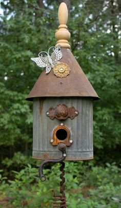 Vintage junk like a rusty funnel and old oil can upcycled to create this adorable bird house