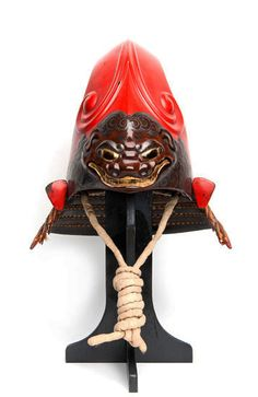 Red fantastic helmet (kawari kabuto 変わり兜) with demonic shishi,' 17th century, iron, cord, lacquer, leather. Japan