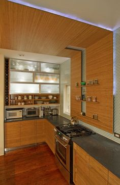 LOVE the vertical wine storage on the side of the cupboards Kitchen Redo, Kitchen Remodel, Kitchen Design, Kitchen Ideas, Upper Cabinets, Kitchen Cabinets, Cupboards, Bamboo Hardwood Flooring, Recycled Glass Countertops