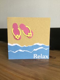 Made by Penny - Created this using sandpaper for the beach, torn paper for the sea and waves. Used the flip flops image from my ScanNcut machine. Just added die cut letters for the sentiment to finish. Simple but effective and I didn't forget that I could flip my image on the ScanNcut so I get a pair of flip flops.
