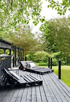 Schon Homebuilt DIY Deck Chairs Of Pallets On The Terrace. Painted In Black So  They Match