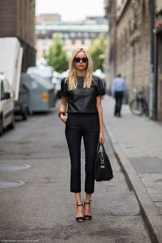 leather top. Black skinny pants.