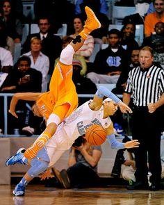 Tennessee's Andraya Carter flips over Jessica Washington of the North Carolina in Chapel Hill, North Carolina. The Lady Vlols won 81-65.
