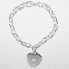 This Delta Zeta Heart Charm Bracelet is the perfect way to show your sorority pride!
