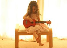 playing the guitar.