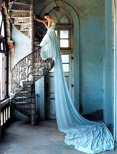 it reminds me of Rapunzel... but ith a dress instead of hair.  Photo by Tim Walker. LOVE the staircase