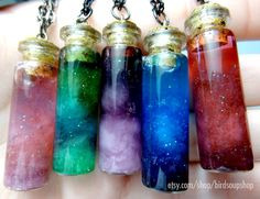 Mini Nebula Necklaces: Take tissue or cotton (cotton works better) and using tweezers, put inside a mini charms bottle from a craft store. Then add your choice of glitter and a few drops of food coloring, then top off with water. Hot glue the top on and add to your chain!