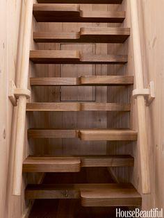 Beautifully crafted stairs of interlocking walnut treads lead to the widow's walk.   - HouseBeautiful.com