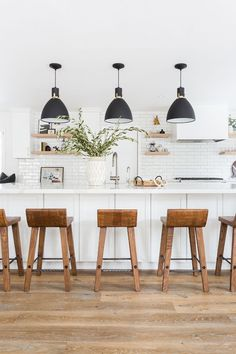 White Kitchen with black pendant lights, cognac leather bar stools, wood floors, open shelving Image Size: 700 x 1050 Pin Boards Name: Home Sweet Home Home Design, Interior Design, All White Kitchen, New Kitchen, Kitchen Small, White Kichen, Crisp Kitchen, Classic White Kitchen, White Kitchen Decor