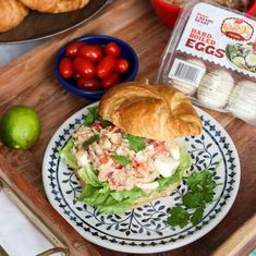 A simple family dinner idea: Smorgasbord! Includes sliced croissants, various raw and cooked veggies, a spicy tuna, and egg salad from @mommygonehealthy. YUM!